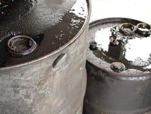 Two oil barrels closeup. Dirty messy dripping black oil barrels closeup stock photo
