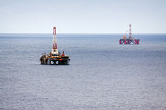 Two oil platforms stock photography