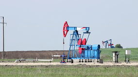 Two oil pump jack. On field stock footage