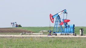 Two oil pump jack stock footage