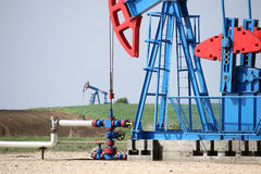 Two oil pump jack Stock Photos