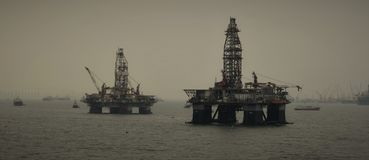 Two oil rigs near Singapore anchorage area. royalty free stock photo