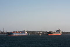 Two oil tanker ships next too each other. Two large oil tanker ships at berth next to each other Stock Photos