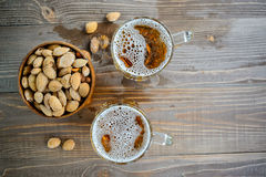 Two Oktoberfest beers with pistachio nuts on a wooden table. Top view Royalty Free Stock Photo