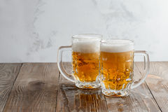 Two Oktoberfest light beers. Two Oktoberfest beers on a wooden table Stock Photography