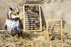 Two old abacus and owl in straw Royalty Free Stock Photography