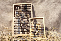 Two old abacus in straw Royalty Free Stock Image