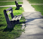 Two old abandoned benches in park Stock Photos