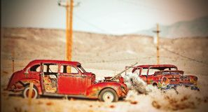 Two Old Abandoned Cars ( tilt-Shift ). This photo was taken in Goldfield, NV  ( tilt-Shift Stock Photography