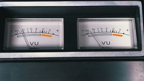 Two old analog dial vu signal indicators with arrow. Meter of audio signal in decibels. Indicator gauge signal, level meter. Dial gauge modes tape recorder stock footage