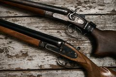 Two old antique shotguns rifle royalty free stock images