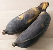 Two Old Banana Fruit on A Wooden Board Stock Photos