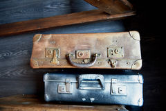 Two old battered suitcase with vintage hardware painted in silver and gold paint Stock Images