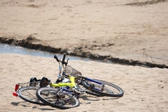 Two old bikes on the beach. Royalty Free Stock Photography