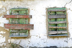 Two old boarded-up window Royalty Free Stock Photo