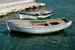 Two old boats. Two old row boats in the greek islands Royalty Free Stock Photo