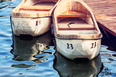 Two old boats at the pier, interesting photo filter Royalty Free Stock Photos