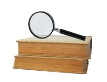 Two old books and magnifying glass Stock Photo