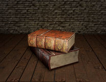 Two old books on wooden table with feather quill in glass inkwell Education concept. 3D illustration Royalty Free Stock Photos