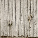Two old broken homemade birdhouses Stock Photography