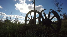Two old broken wooden horse carriage on field. Timelapse 4K stock footage