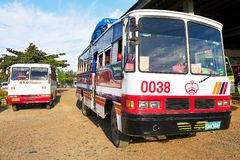 Two old buses waiting for passengers at the bus terminal stock images
