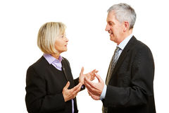 Two old businesspeople talking Royalty Free Stock Images