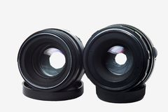 Two old camera lenses on a white background stock photos