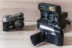 Two old cameras and camcorder. stock photo