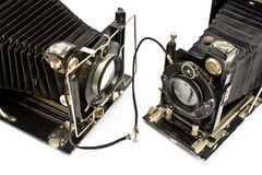 Two Old Cameras holding hands Stock Images