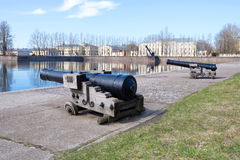 Free Two Old Cannons On The Shore Of The Italian Pond In The May Afternoon. Kronstadt, Russia Stock Images - 92741694