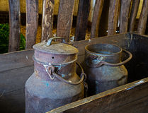 Two old cans in truck in the barn Stock Photos