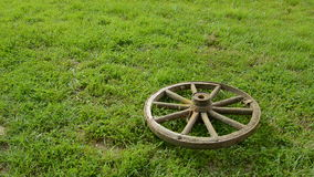 Two old carriage wheels on the grass stock video