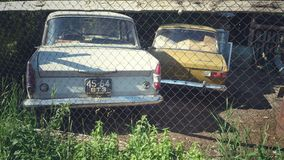 Moskvich 412 and 408. Two old cars produced by the USSR, which have stood for a long time near the house Royalty Free Stock Images
