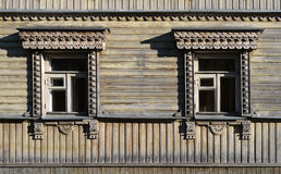Two old carved wooden windows Royalty Free Stock Photos