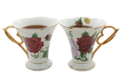 Two old china teacups. Two old china teacups with strong tea for two Royalty Free Stock Photo