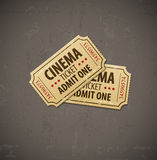 Two old cinema tickets for cinema over grunge background Royalty Free Stock Images
