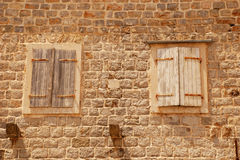 Two old closed italian windows with shutters Stock Images