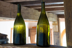 Two old dark green Normandy cider bottles Royalty Free Stock Photos