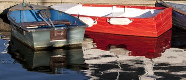Two old Dinghies. Tied up at a pontoon Royalty Free Stock Photo