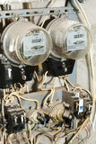 Two old, dirty meters for electricity Stock Photo