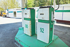 Two old dispensers at a gas station Stock Image
