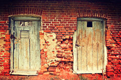 Two old doors and brick wall instagram stile Royalty Free Stock Image