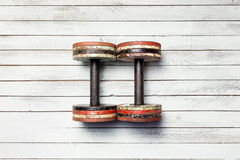 Two old dumbbells on white wood Royalty Free Stock Photography