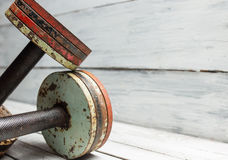 Two old dumbbells on white wood Royalty Free Stock Image