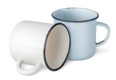 Two old enameled mugs beside. Isolated on white background Stock Images