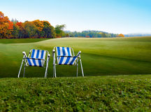 Two old fashioned camping chairs Royalty Free Stock Image
