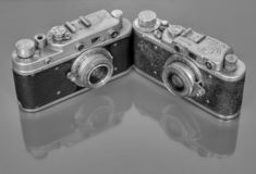 Two old cameras with reflection stock image
