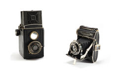 Two old film photo cameras on white background Stock Images