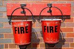 Two old fire buckets. Royalty Free Stock Photo